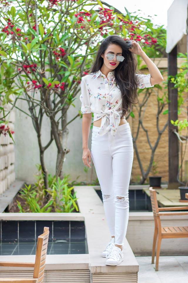 all white jeans and floral top by globus