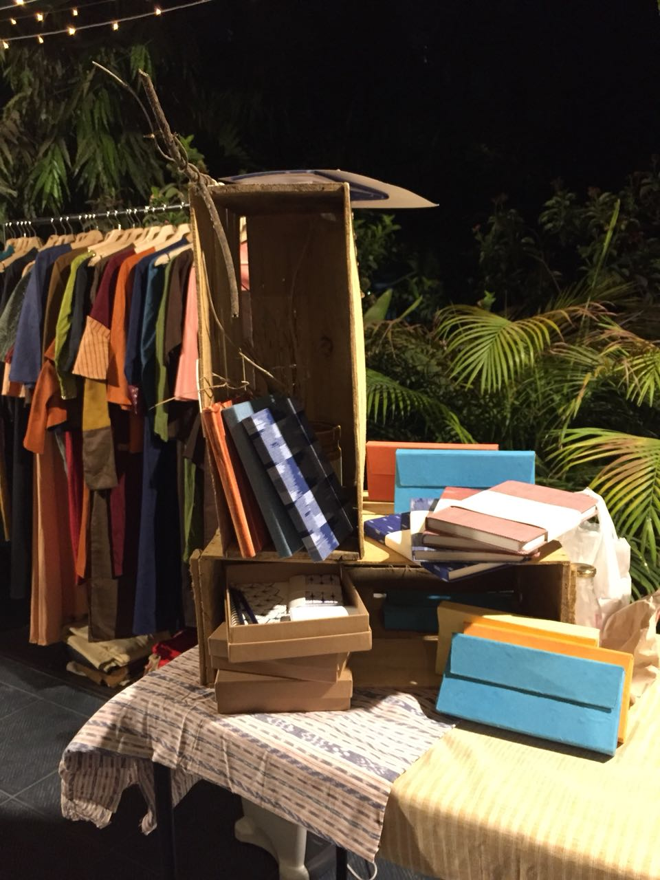 clothes and stationary items at night gallery
