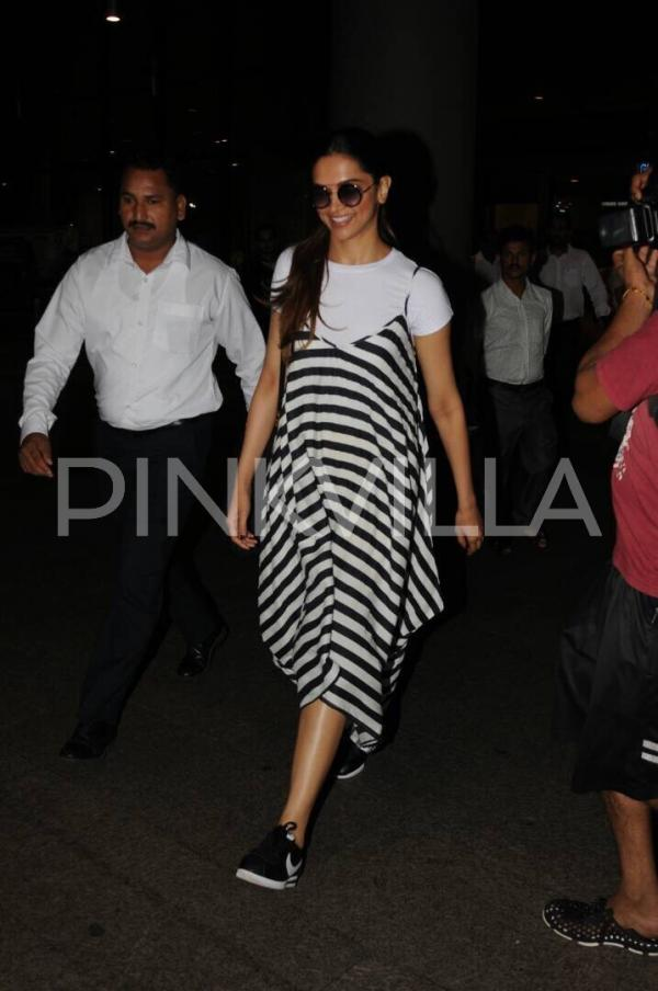 cute striped dress and white t shirt of deepika