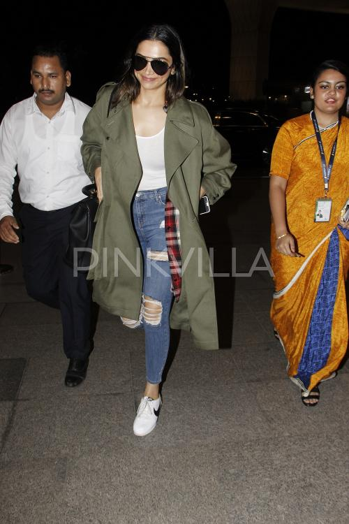 deepika in olive green coat and ripped jeans