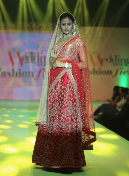 red and golden lehenga by viral ashish