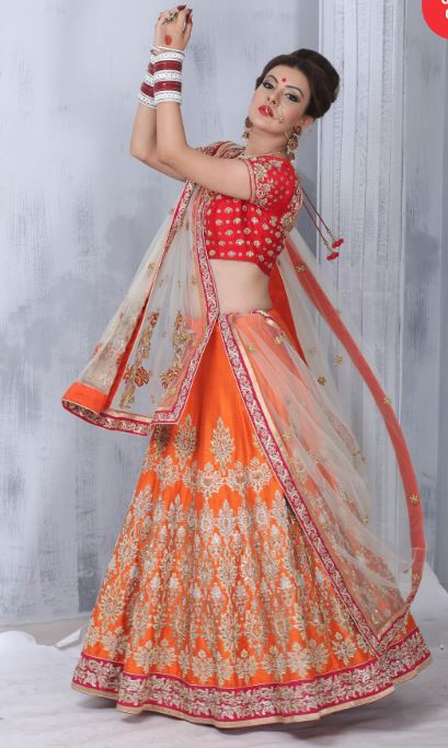 red and orange lehenga by designers viral ashish
