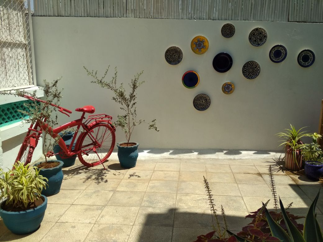 red bicycle and ceramic plates at fashion studio