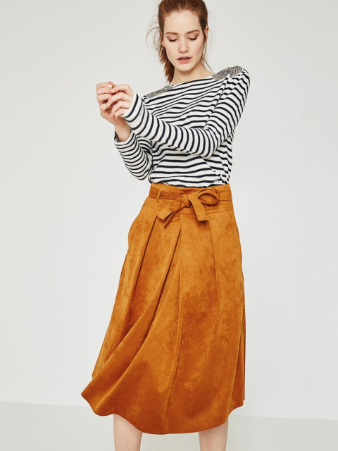 striped black top and yellow velvety skirt
