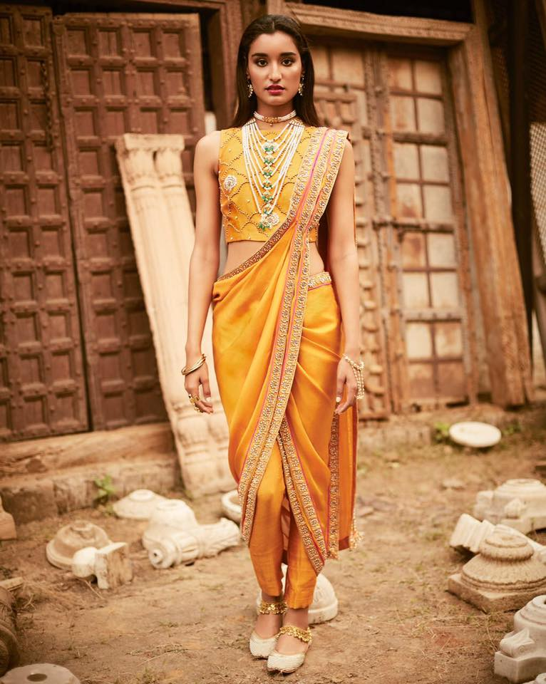 stylish yellow drapey saree pant at elan store