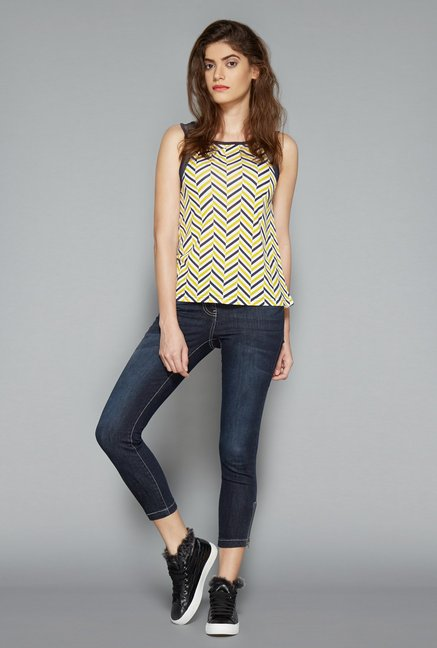 yellow top and skinny blue jeans by westside