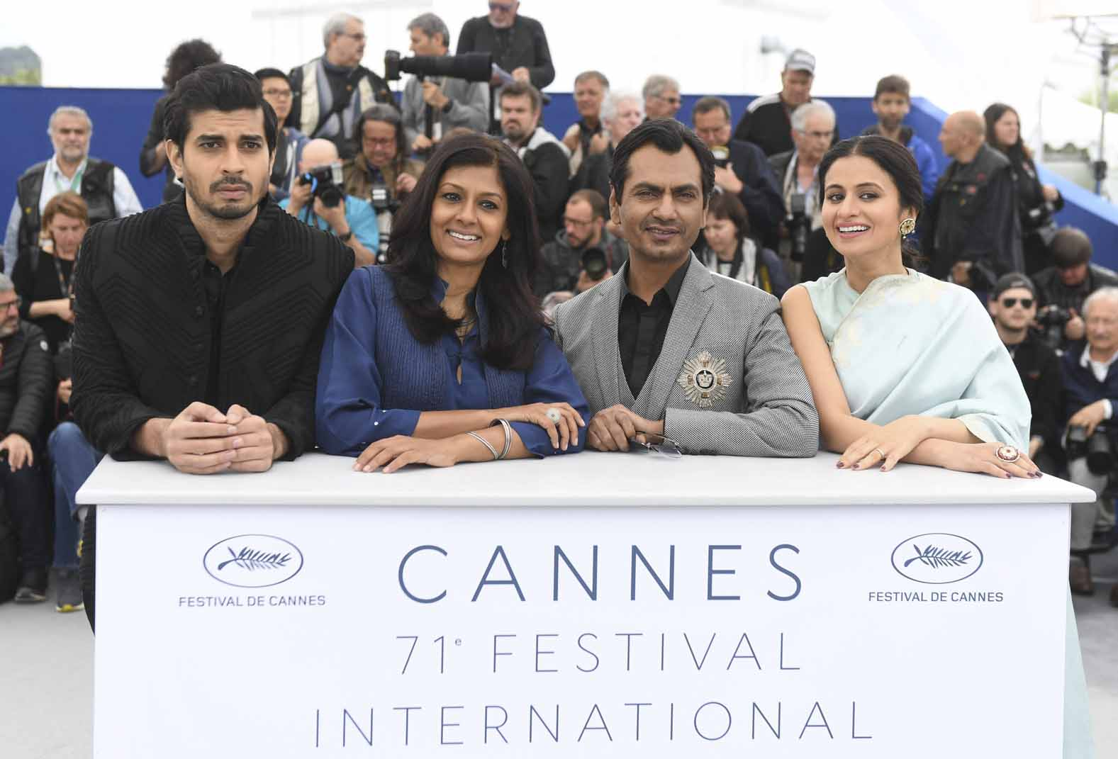 Actor Tahir Raj Bhasin, from left, director Nandita Das, actor Nawazuddin Siddiqui and Rasika Dugal pose for photographers during a photo call for the film 'Manto' at the 71st international film festival, Cannes, 2018