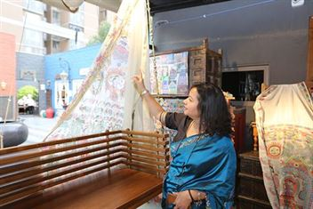 woman admiring dupatta display at Boho Homes